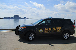 sheriff's car with water in background